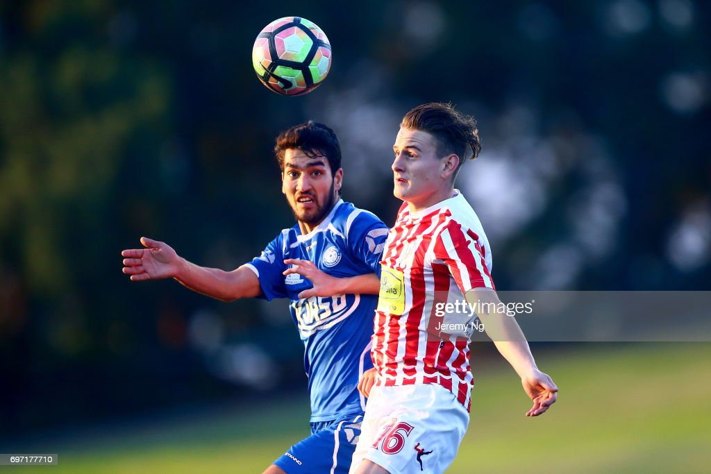 Mohammad Rahimi of Olympic FC and Jacob Ott of Parramatta FC contest for the ball during the NSW NPL Men's match between Sydney Olympic FC and Parramatta FC on June 18, 2017 in Sydney, Australia.