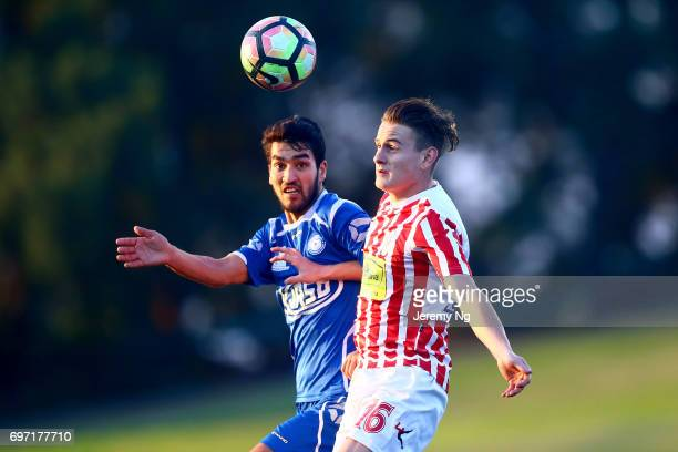 Mohammad Rahimi of Olympic FC and Jacob Ott of Parramatta FC contest for the ball during the NSW NPL Men's match between Sydney Olympic FC and...