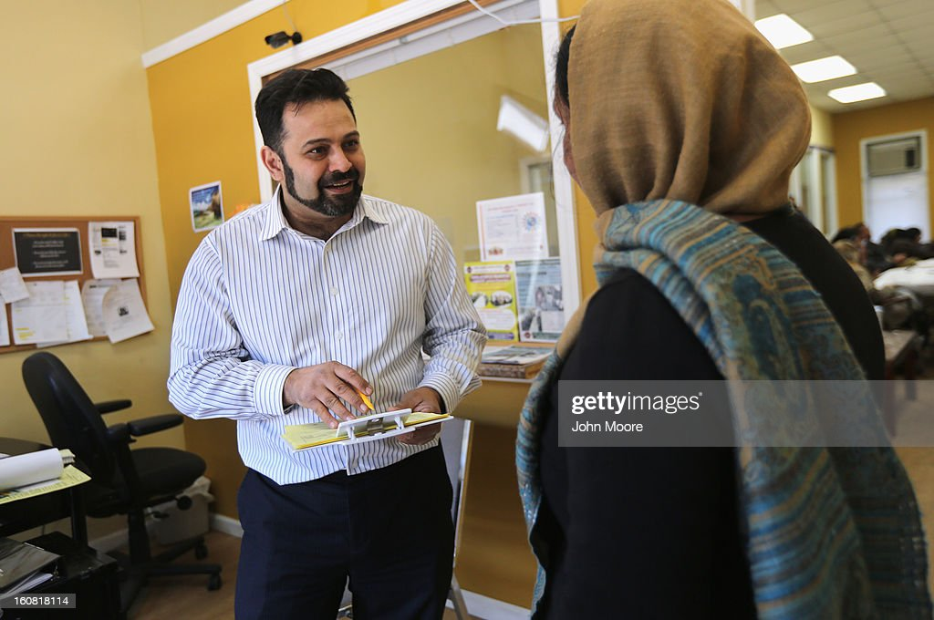 Mohammad Razvi, executive director and founder of the Council of Peoples Organization (COPO), speaks with a Pakistani immigrant during an English and citizenship class on February 6, 2013 in New York City. The non-profit COPO, founded in early 2002 shortly after the 9/11 attacks, is designed to help immigrants, mostly from Pakistan, learn English, assimilate to American culture and, in many cases, gain U.S. citizenship.