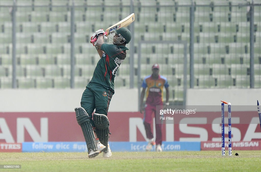 Mohammad Saifuddin of Bangladesh U19 gets bowled out by Keemo Paul of West Indies U19 (not in the picture) during the ICC U 19 World Cup Semi-Final match between Bangladesh and West Indies on February 11, 2016 in Dhaka, Bangladesh.