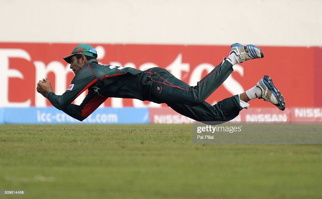 Mohammad Saifuddin of Bangladesh U19 takes a catch to get the wicket of Shimron Hetmyer of West Indies U19 during the ICC U 19 World Cup Semi-Final match between Bangladesh and West Indies on February 11, 2016 in Dhaka, Bangladesh.