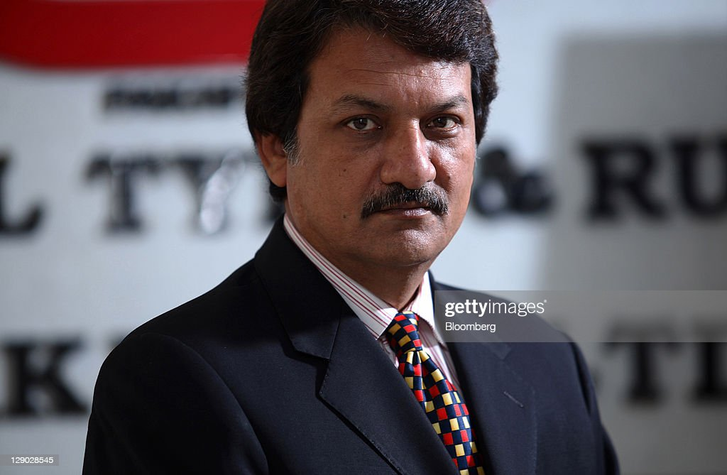 Mohammad Shahid Hussain, chief executive officer of General Tyre & Rubber Co. of Pakistan Ltd., poses for a photograph in Karachi, Pakistan, on Monday, ... - mohammad-shahid-hussain-chief-executive-officer-of-general-tyre-co-picture-id129028545