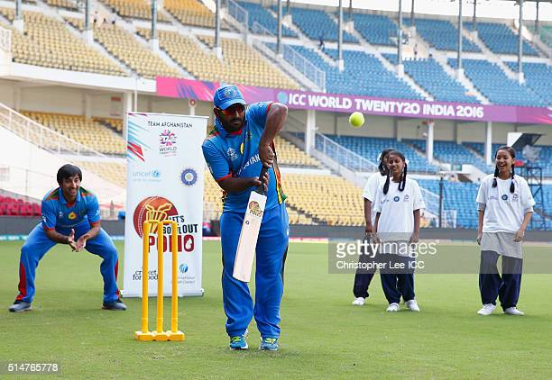 Mohammad Shahzad and Asghar Stanikzai Captain of Afghanistan take part in a kids game of cricket during the ICC Cricket For Good and Team Swachh...