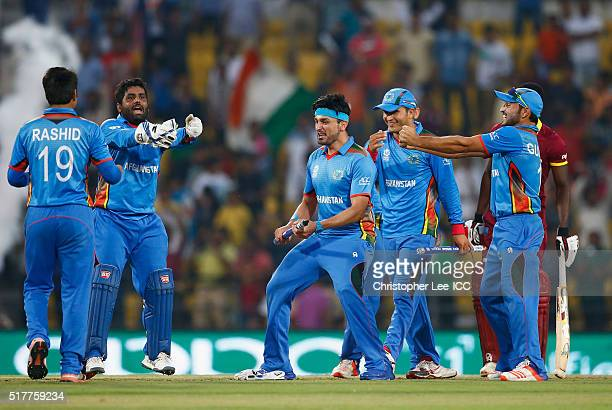 Mohammad Shahzad Hamid Hassan and Gulbadin Naib of Afghanistan celebrate their victroy during the ICC World Twenty20 India 2016 Group 1 match between...