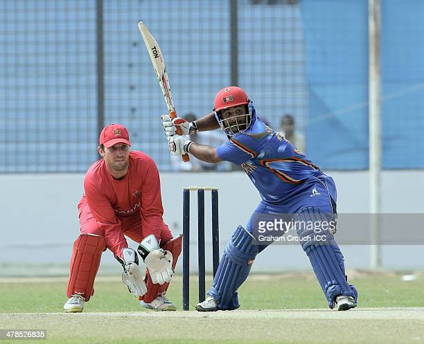 Mohammad Shahzad of Afghanistan batting in front of wicketkeeper Brendan Taylor of Zimbabwe in the warm up match between Afghanistan and Zimbabwe the...