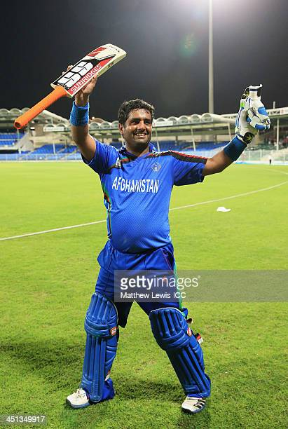 Mohammad Shahzad of Afghanistan celebrates his teams win during the ICC World Twenty20 Qualifier between Afghanistan and Nepal at the Sharjah Cricket...