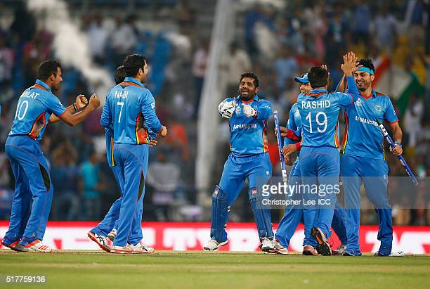 Mohammad Shahzad of Afghanistan copies the West Indies dance in celebration as the Afghanistan team win the match during the ICC World Twenty20 India...