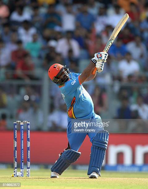 Mohammad Shahzad of Afghanistan hits out for six runs during the ICC World Twenty20 India 2016 Super 10s Group 1 match between South Africa and...