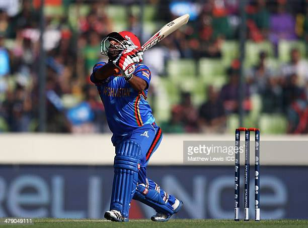 Mohammad Shahzad of Afghanistan hits out on the first ball only to be caught by Mahmudullah of Bangladesh during the ICC World Twenty20 Bangladesh...