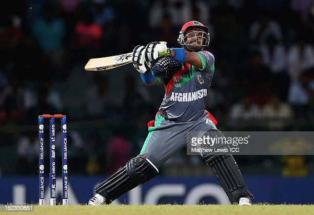 Mohammad Shahzad of Afghanistan hits the ball towards the boundary during the ICC World Twenty20 match Group A match between India and Afghanistan at...