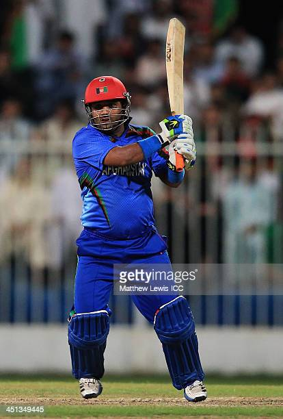 Mohammad Shahzad of Afghanistan hits the ball towards the boundary during the ICC World Twenty20 Qualifier between Afghanistan and Nepal at the...