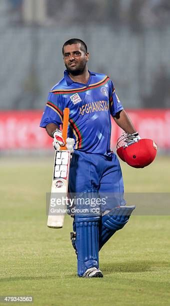 Mohammad Shahzad of Afghanistan leaves after scoring a half century batting during Afghanistan v Hong Kong match at the ICC World Twenty20 Bangladesh...