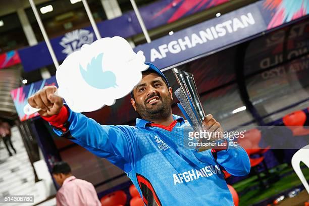 Mohammad Shahzad of Afghanistan takes a selfie using a selfie mirror of himself with his Man of the Match Award during the ICC Twenty20 World Cup...