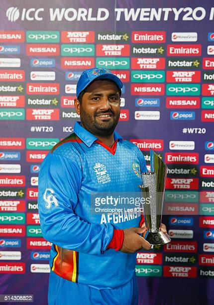 Mohammad Shahzad of Afghanistan with his Man of the Match Award during the ICC Twenty20 World Cup Group B match between Scotland and Afghanistan at...