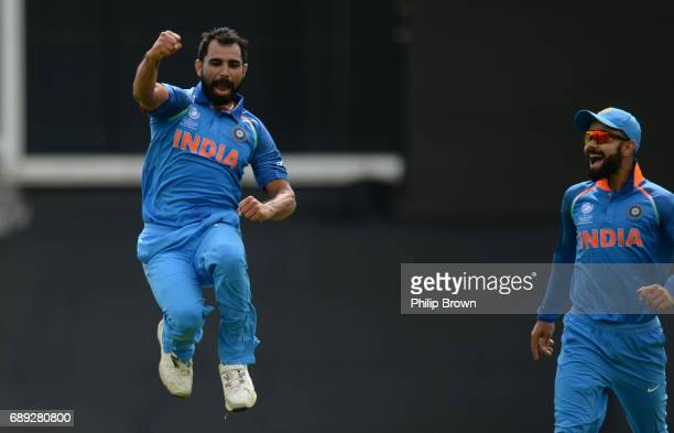 Mohammad Shami of India celebrates with Virat Kohli after dismissing Neil Broom of New Zealand during the ICC Champions Trophy Warmup match between...