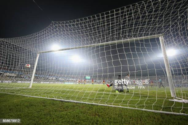 Mohammad Sharifi of Iran scores his team's second goal against goalkeeper Ibrahima Sylla of Guinea during the FIFA U17 World Cup India 2017 group C...