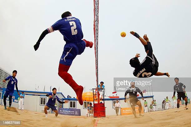Mohammad Shukri Jaineh of Brunei Darussalam kicks over the net against Sornpithak Sriring of Thailand during the Beach Sepaktakraw Men's Regu...