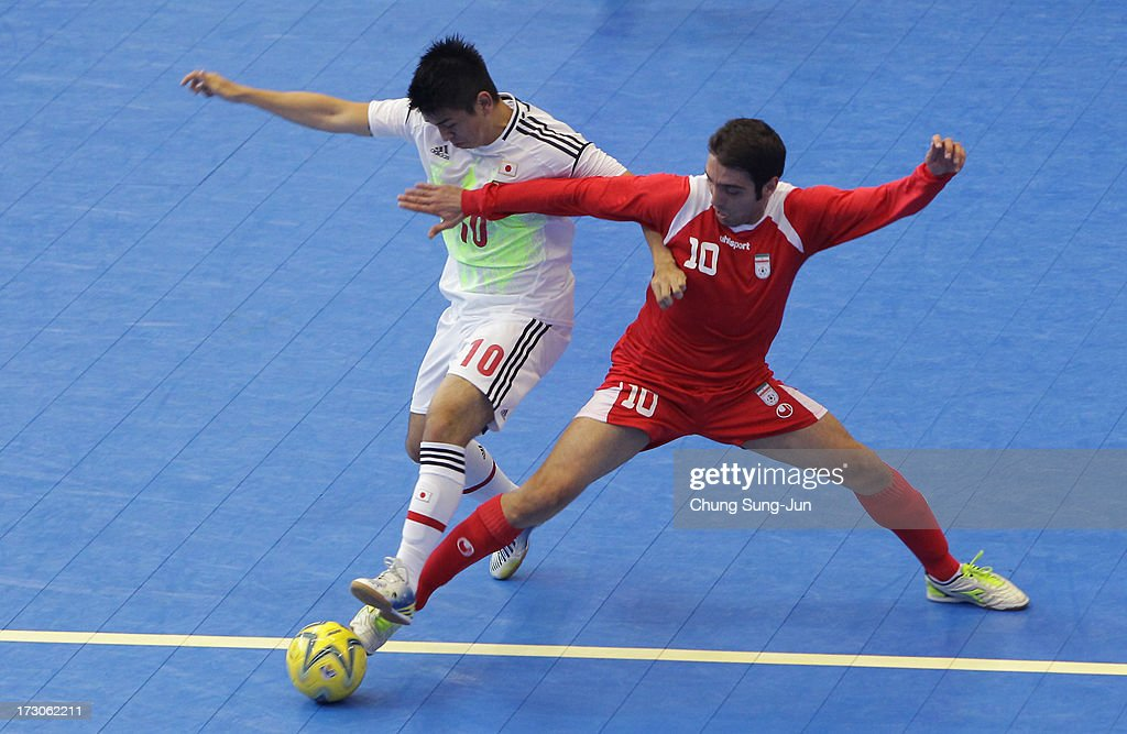 Mohammad Taheri # 10 of Iran competes for the ball with Katsutoshi Henmi # 10 of Japan during the Men's Futsal Gold Medal match at Songdo Global University Campus Gymnasium during day eight of the 4th Asian Indoor & Martial Arts Games on July 6, 2013 in Incheon, South Korea.