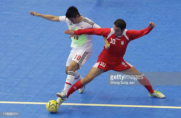 Mohammad Taheri of Iran competes for the ball with Katsutoshi Henmi of Japan during the Men's Futsal Gold Medal match at Songdo Global University...
