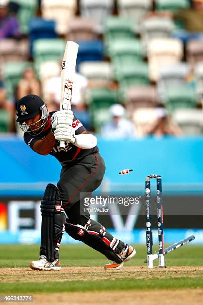 Mohammad Tauqir of the United Arab Emirates is bowled by Jerome Taylor of West Indies during the 2015 ICC Cricket World Cup match between the West...