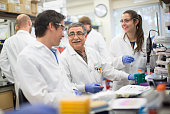 Mohammad Zafari center an associate scientist with Jounce Therapeutics works with Jeff Smith left and Ana Nido in the company laboratory in Cambridge...