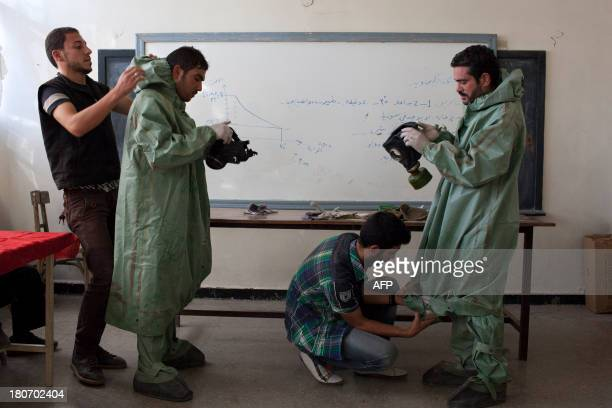Mohammad Zayed an Aleppo University student shows Syrian citizens hows to put protective gear as he instructs them with rudimentary means of how to...