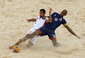 Mohammadali Mokhtari of Iran and Moreira Ozu of Japan compete for the ball during the Men's Beach Soccer gold medal match between Iran and Japan...
