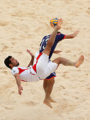 Mohammadali Mokhtari of Iran kicks the ball infront of Takasuke Oba of Japan during the Men's Beach Soccer gold medal match between Iran and Japan...