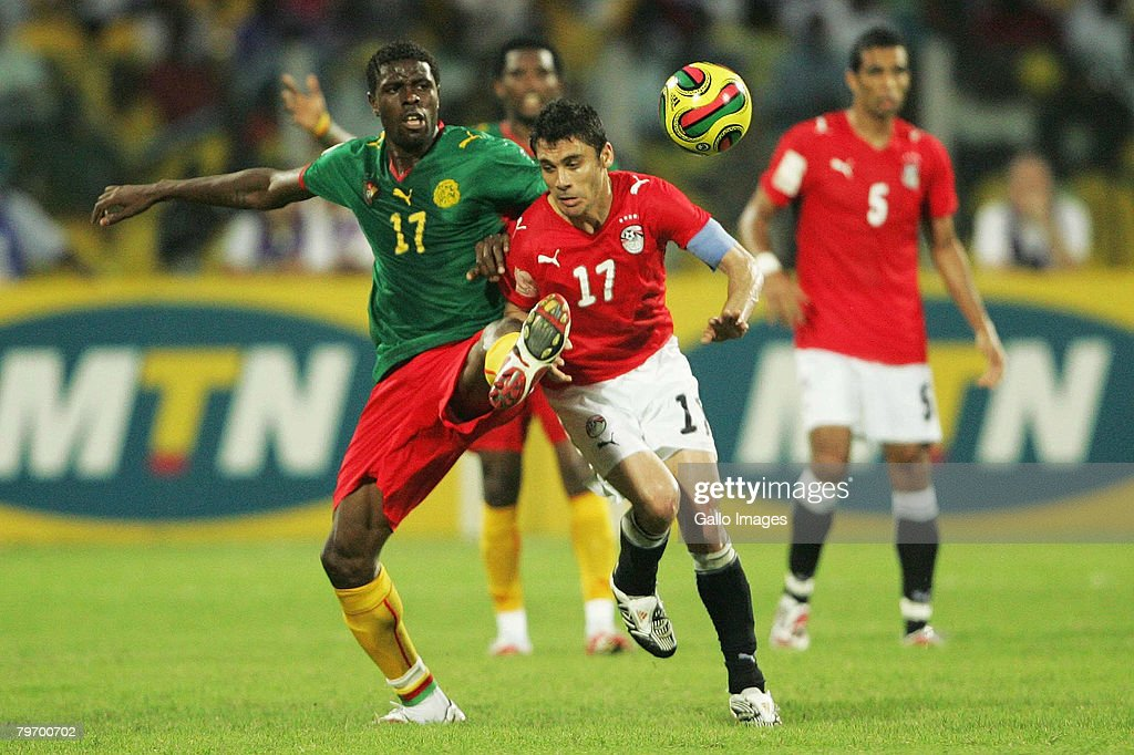 Mohammadou Idrissou of Cameroon and Ahmed Hassan of Egypt battle for the ball during the AFCON Final match between Cameroon and Egypt at the Ohene...