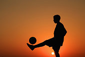 Mohammed a 14yr old local kid who can do over 3000 consecutive 'keepups' practises as the sun sets at the FIFA U17 World Cup UAE 2013 Fan Park on the...