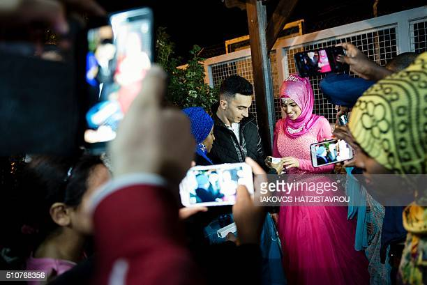 Mohammed a Palestinian refugee from Lebanon and Loula a Yemeni refugee exchange rings during their engagement party at the Kofinou centre for...
