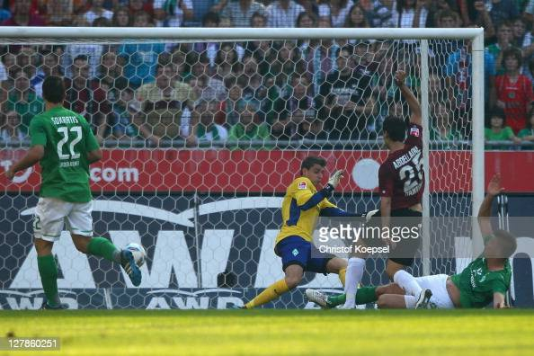 Mohammed Abdellaoue of Hannover scores the second goal against Sokratis Papastathopoulos Sebastian Mielitz and Sebastian Proedl of Bremen ring the...