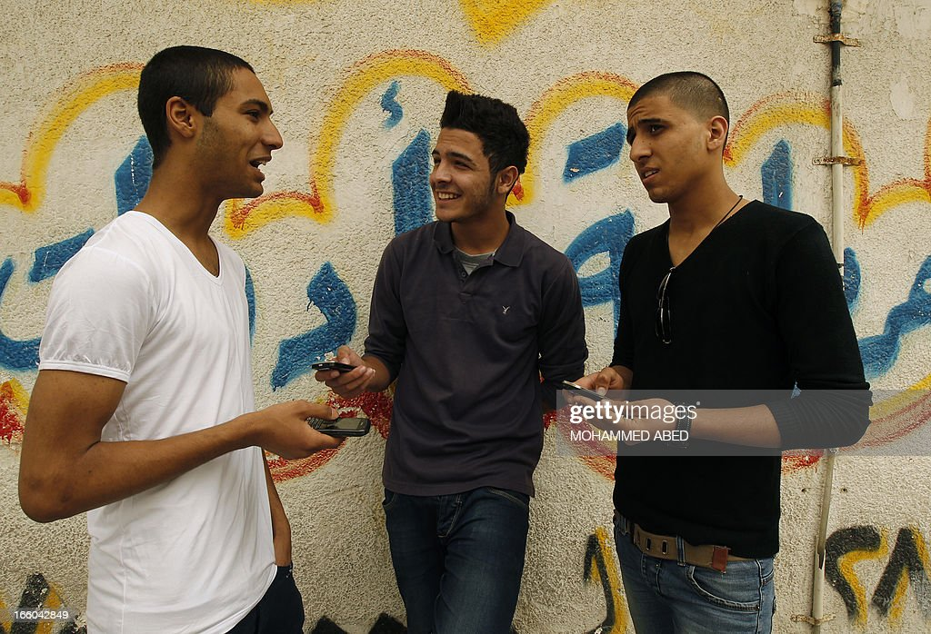 Mohammed Abo Ramdan (C) stands with his friends Ayman al-Sayed (R) and Tarq Al-Naqeb, (L) in Gaza City on April 8, 2013, both of whom had their heads shaved after Hamas security forces in Gaza rounded them up with other young men and forced them to get a haircut on grounds of inappropriate hairstyles. Some of the youths have even been beaten for styling their hair in a way deemed unacceptable to Gaza's ruling Islamist movement, or wearing low-hung trousers, the Palestinian Centre for Human Rights said.