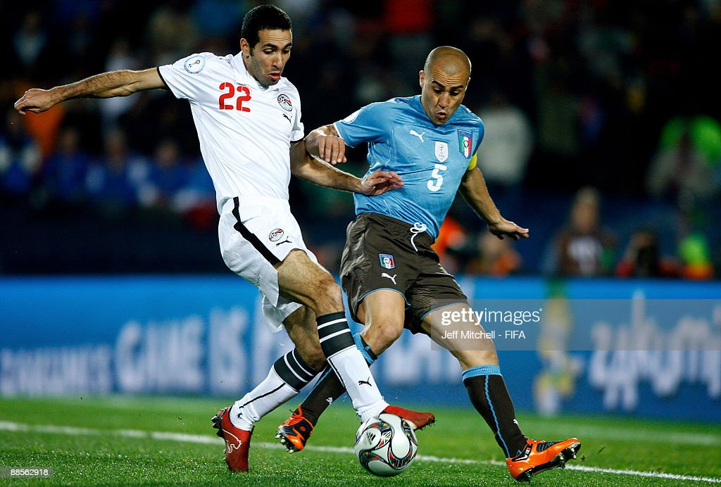 Mohammed Aboutrika of Egypt holds off Fabio Cannavaro of Italy during the FIFA Confederations Cup Group A match between Egypt and Italy at the Ellis...