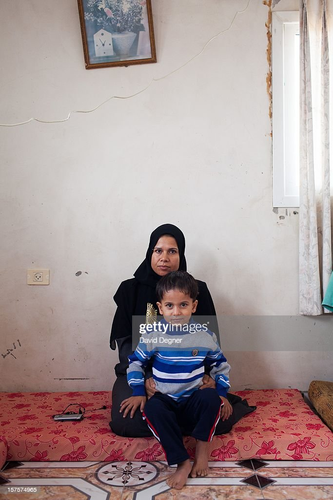 Mohammed Abu Mustafa, with his mother and sister, in their home in southern Gaza on November 21, 2012. Mohammed Abu Mustafa was the subject of a film called Precious Life, a 2010 documentary.