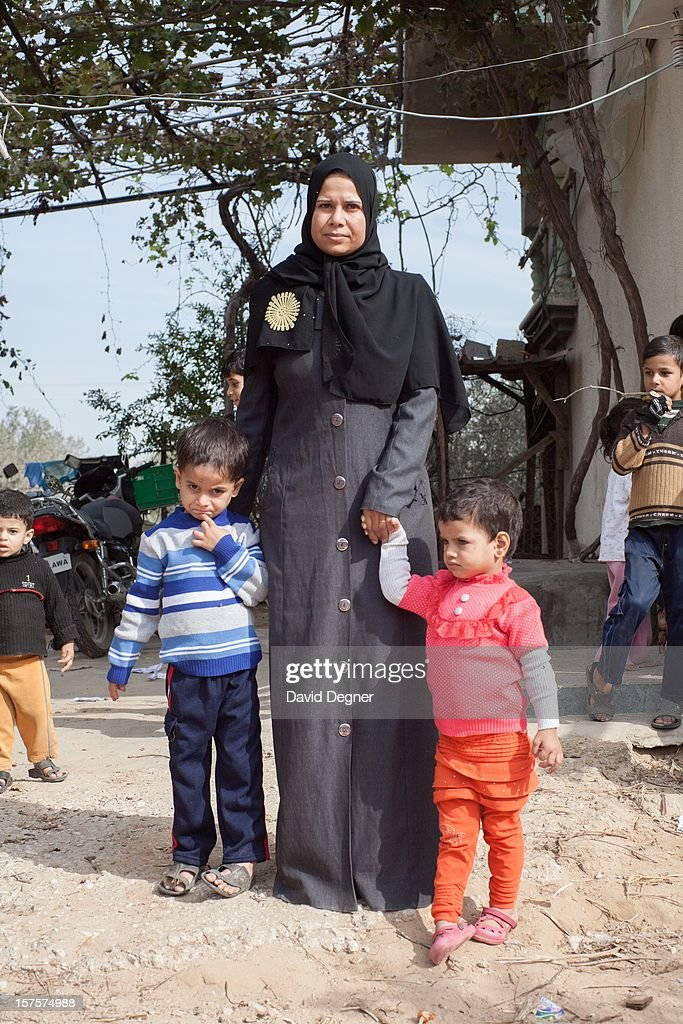 Mohammed Abu Mustafa, with his mother and sister, outside their home in southern Gaza on November 21, 2012. Mohammed Abu Mustafa was the subject of a film called Precious Life, a 2010 documentary.