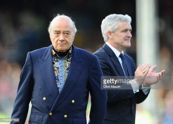 Mohammed Al Fayed and Mark Hughes of Fulham waves on the pitch after the Barclays Premier League match between Fulham and Arsenal at Craven Cottage...