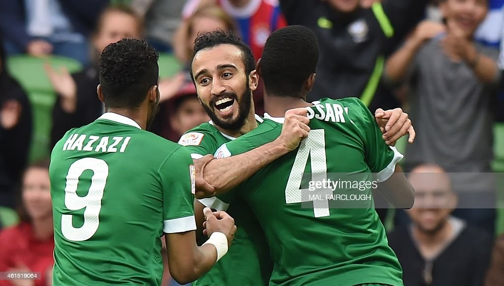 Mohammed Al Sahlawi of Saudi Arabia (C) celebrates after scoring a goal with <a gi-track='captionPersonalityLinkClicked' href=/galleries/search?phrase=Naif+Hazazi&family=editorial&specificpeople=5779932 ng-click='$event.stopPropagation()'>Naif Hazazi</a> (L) and Abdulla Aldossary (R) during the Group B Asian Cup football match between North Korea and Saudi Arabia in Melbourne on January 14, 2015. USE
