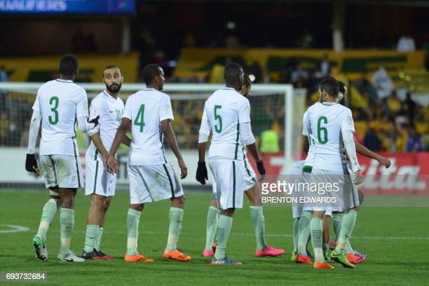 Mohammed Al Sahlawi of Saudi Arabia looks back while leaving the field after his team lost 23 to Australia during the World Cup football Asian...