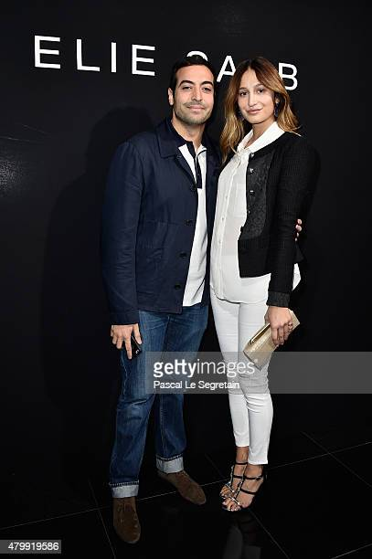 Mohammed Al Turki and a guest attend the Elie Saab show as part of Paris Fashion Week Haute Couture Fall/Winter 2015/2016 on July 8 2015 in Paris...