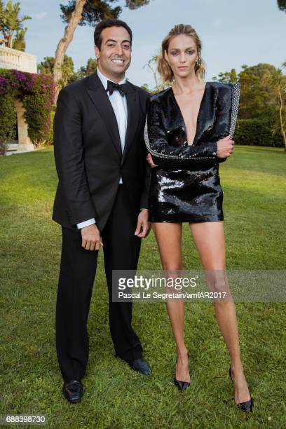 Mohammed Al Turki and Anja Rubik attend the amfAR Gala Cannes 2017 at Hotel du CapEdenRoc on May 25 2017 in Cap d'Antibes France