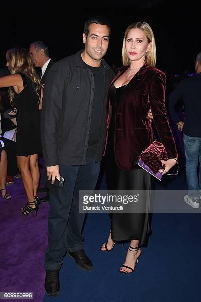 Mohammed Al Turki and Inga Rubenstein attend the Versace show during Milan Fashion Week Spring/Summer 2017 on September 23 2016 in Milan Italy
