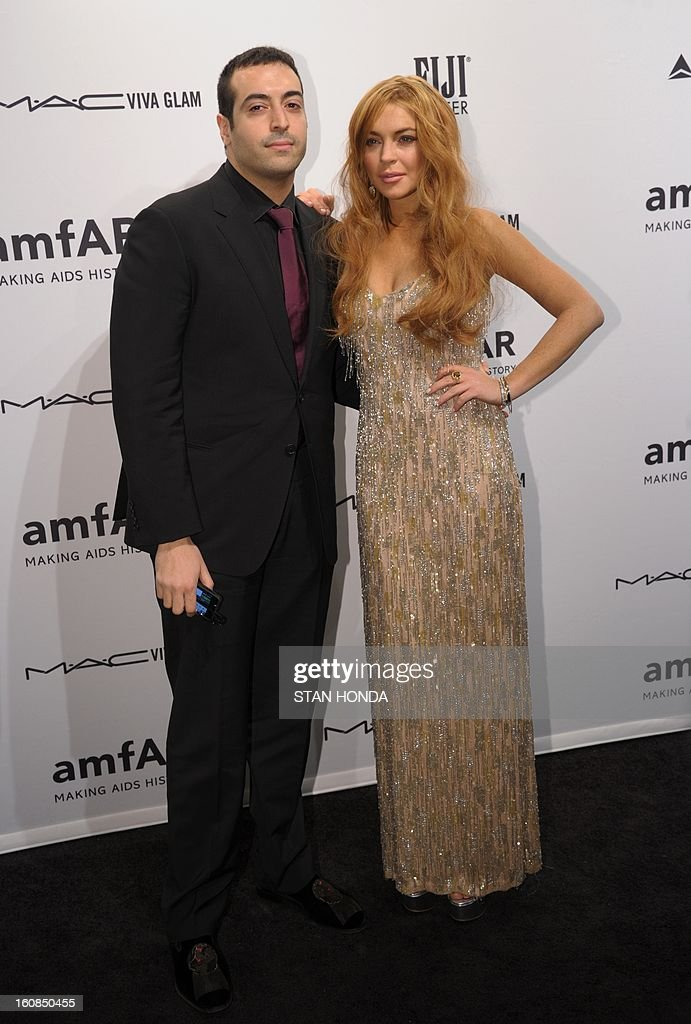 Mohammed Al Turki (L) and Lindsay Lohan (R) arrive at the amfAR (The Foundation for AIDS Research) gala that kicks off the Mercedes-Benz Fashion Week February 6, 2013 in New York. AFP PHOTO/Stan HONDA
