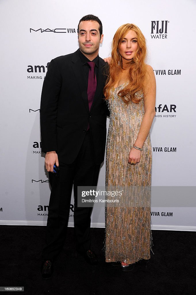 Mohammed Al Turki (L) and Lindsay Lohan attend the amfAR New York Gala to kick off Fall 2013 Fashion Week at Cipriani Wall Street on February 6, 2013 in New York City.