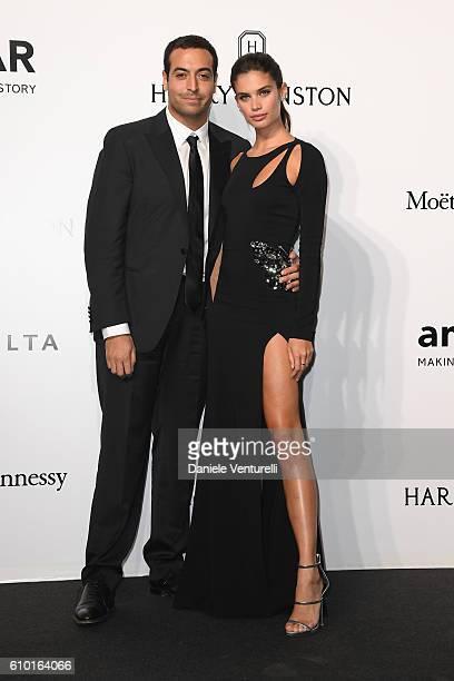 Mohammed Al Turki and Sara Sampaio walk the red carpet of amfAR Milano 2016 at La Permanente on September 24 2016 in Milan Italy