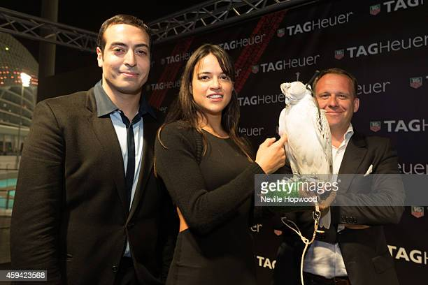 Mohammed Al Turki Michelle Rodriguez and Kolia Neveux pose with a Gyrfalcon at the TAG Heuer celebration for the last race of the Grand Prix season...