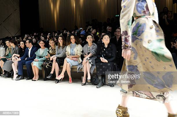 Mohammed al Turki Mira Duma guest Beren Saat Kangana Ranaut and Carina Lau sit in the front row at Burberry Womenswear Autumn/Winter 2014 at...