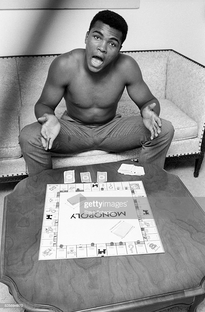Mohammed Ali playing the board game Monopoly
