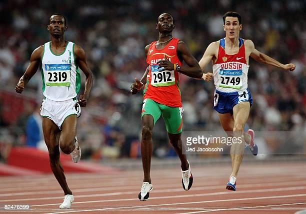 Mohammed AlSalhi of Saudi Arabia Abubaker Kaki of Sudan and Dmitry Bogdanov of Russia compete in the men's 800m heats held at the National Stadium...