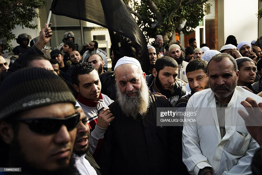 Mohammed al-Zawahiri (C), leader of Salafi Jihad in Egypt, takes part in a demonstration organised by Egyptian Islamists against the French intervention in Mali on January 18, 2013 in Cairo. The brother of Al-Qaeda chief Ayman al-Zawahiri joined dozens of Egyptian Islamists in a protest near the French embassy in Cairo. AFP PHOTO/GIANLUIGI GUERCIA